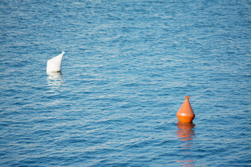 orange and white buoys