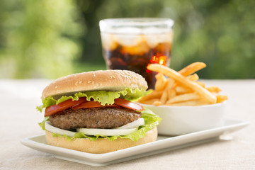 Hamburger with french fries and soft drink