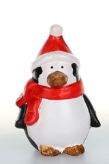Christmas figurine of penguin with santa hat