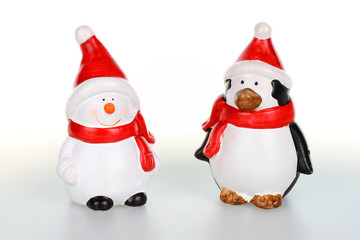 Snowman and penguin with Santa clause outfit