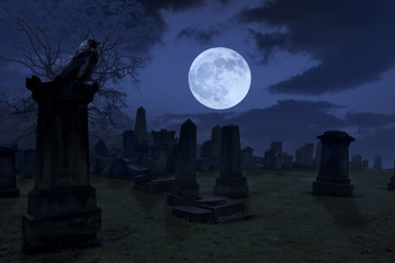 Spooky night at cemetery with old gravestones, full moon and bla
