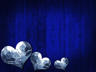 Christmas with silver hearts  and blue wood background