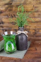 Vase of estragon and glass of estragon drink