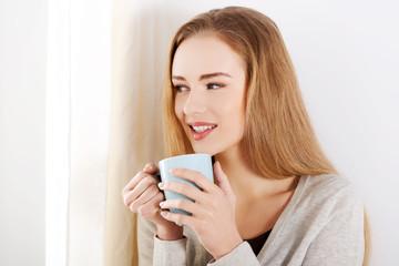 Beautiful caucasian woman drinking hot coffee