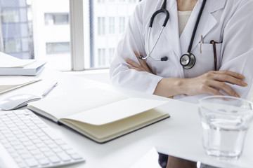 Women doctors are arm in arm