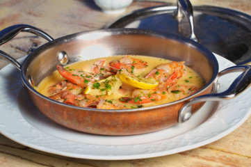 Shrimps in a garlic butter sauce dish