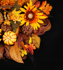 Autumn or Thanksgiving Bouquet over black background. Pumpkin