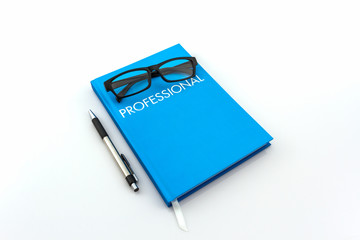 "Blue diary book with the word"" professional"" ."