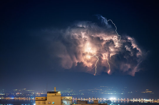 Electrical storm over the city by night