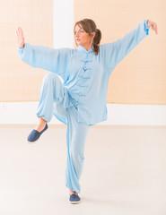 Woman doing qi gong tai chi exercise