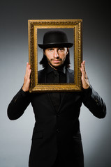 Man in topper hat and picture frame