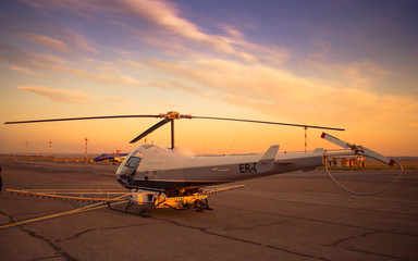 Helicopter waiting for takeoff at sunset
