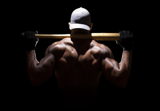 Baseball player from behind in dramatic lighting