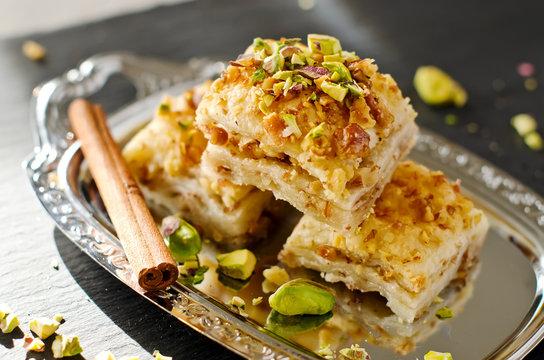 Turkish pistachio pastry dessert  baklava with green pistachios