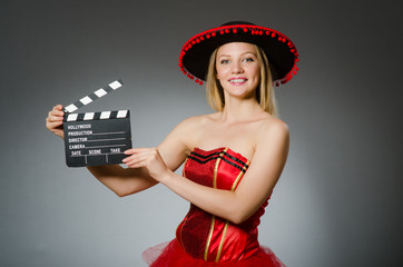 Funny mexican woman with sombrero and movie clapboard