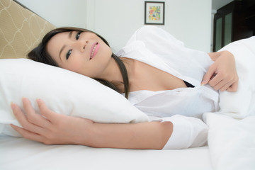 Sexy asian girl on bed
