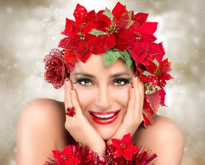 Happy Christmas Girl. Beautiful Woman in red. Holiday Hairstyle