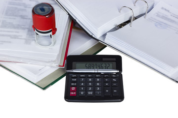 Documents with stamp and calculator