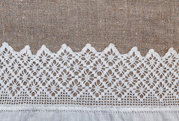 Burlap background with lacy and linen cloth
