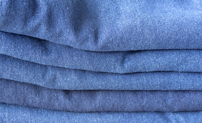Stack of blue jeans background