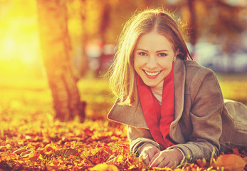 happy young beautiful woman in the autumn