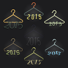 Set of 7 Hangers with Numerals Hanging: 2015. Black backdrop.