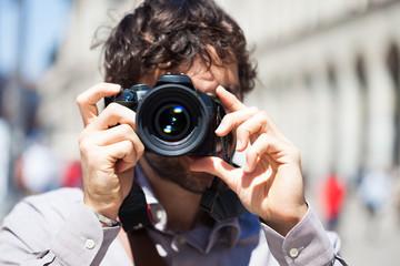 Photographer using his camera