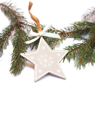 wooden star decoration on a Christmas tree