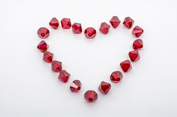 Macro Shot of A Collection Of Red Beads In Form Of A Heart