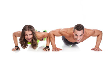 beautiful fitness young sporty couple doing pushups