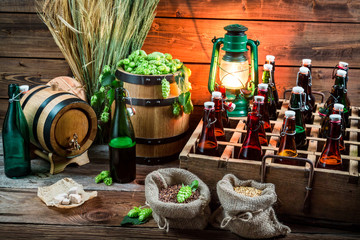 Tasting home-brewed beer in the cellar