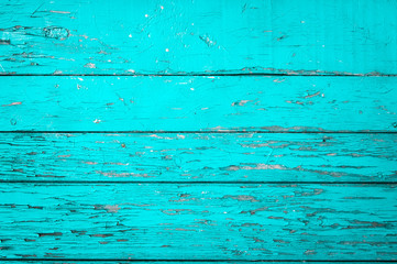 Old wooden painted background in turquoise color.