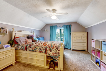 Kids room interior. Wooden bed with drawers and toys