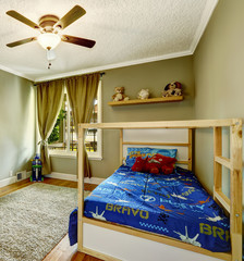 Boys room interior in olive tones