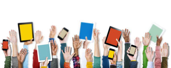 Diverse Hands Holding Digital Devices