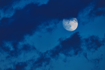 Moon in the blue summer sky