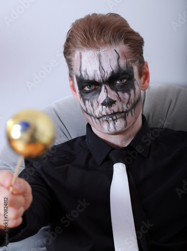 portrait young man with skull makeup halloween face art