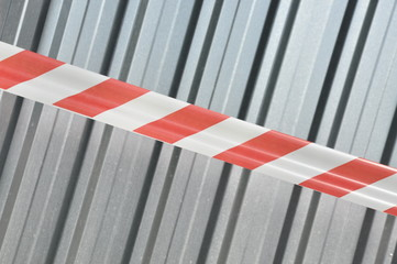 Warning tape with corrugated sheet metal construction