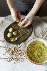 male hands preparing homemade falafel with chickpeas flour