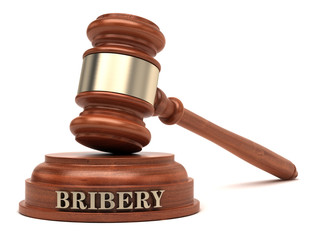 Bribery text on sound block & gavel