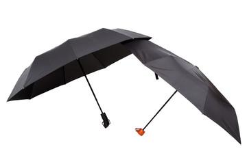 Modern black umbrellas in the unfolded form.