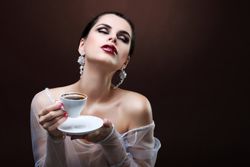 beautiful young girl  with  the cup of coffee