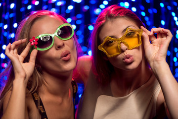 Two party girls with glasses