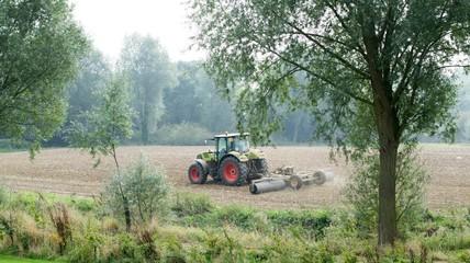 Blue Tractor in a field