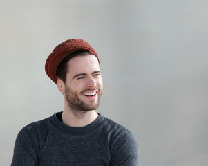 Trendy guy with hat laughing