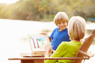 Grandmother With Grandson Outdoors Painting Landscape