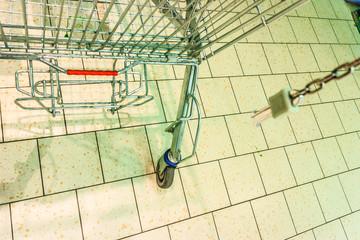 empty shopping trolley cart in gorcery store