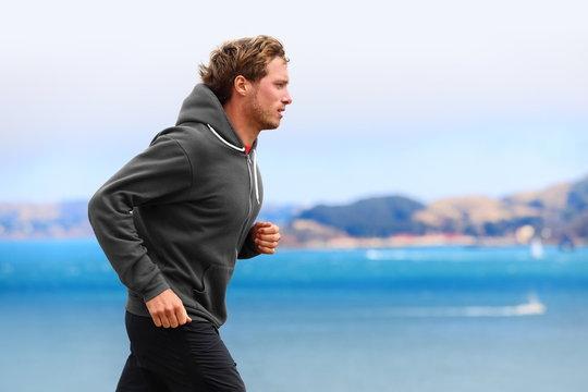 Athlete man running in sweatshirt hoodie