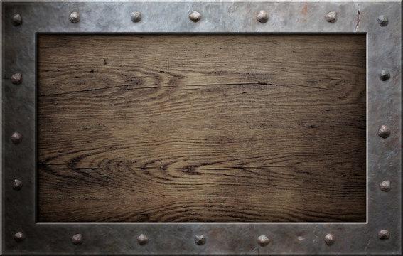 old metal frame over wooden background