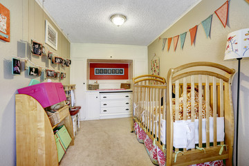 Baby room interior with wooden crib
